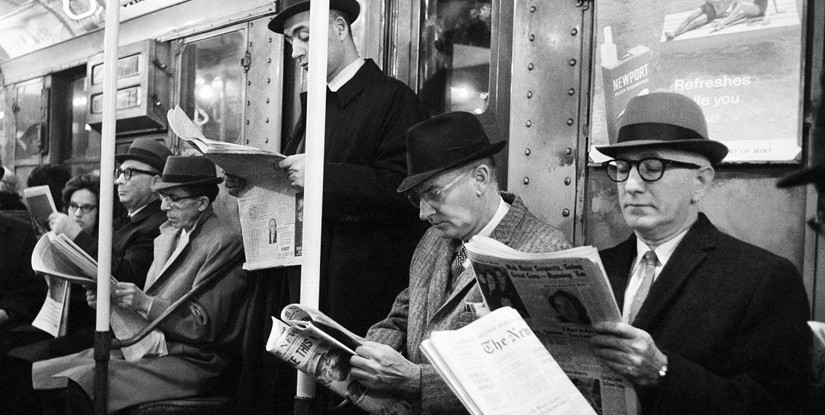 Riders read their morning newspapers on New York's subway en route to work, on April 1, 1963 after the end of the city's 114-day newspaper strike; Courtesy of AP Photo/Jacob Harris
