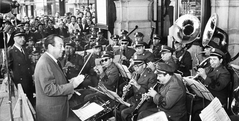 Mayor Robert Wagner conducts the Department of Sanitation Band at the rededication ceremony of Carnegie Hall after threats to its preservation, September 26, 1960; Courtesy of The New York Times