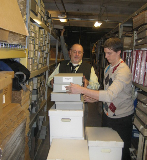 Charlie Tonetti and Christian Kronenwetter (L to R) carefully move boxes containing the Association for Preservation Technology International (APT) Archives into their new home at the Philadelphia Athenaeum. | Photo courtesy of Association for Preservation Technology International (APT)